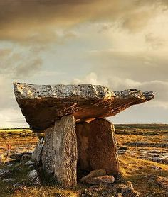 "Poulnabrone dolmen in Ireland. (Poll na mBrón in Irish, meaning ""hole of the quern stones"" (bró in Irish)) is a portal tomb in the Burren, County Clare, Ireland, dating back to the Neolithic period, probably between 4200 BCE and 2900 BCE. It is situated 5 miles south of Ballyvaughan in the parish of Carran, 6 miles north-west of Kilnaboy."