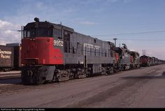 One of Southern Pacific's three U50 diesels sits in the dead line at Taylor Yard in Los Angeles on March 16, 1975. Behind it are two Cotton Belt GP40s and, further back, a second U50.