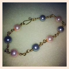 Glass pearl golden bracelet I made while watching jewellery maker