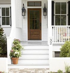 Love those lights......farmhouse entry (white floor, shutters, wooden door, lanterns, side light front porch sep house #, planters both sides)