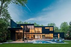 Toronto-based studio Guido Constantino has designed the 44 Belvedere Residence.  This 10,000 square foot, two story contemporary home is located in South West Oakville, a town in Halton Region, on Lake Ontario in Southern Ontario, Canada.