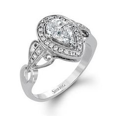 Shop online SIMON G TR604 Halo 18K - White Gold Diamond Engagement Ring at Arthur's Jewelers. Free Shipping
