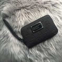 Marc by Marc Jacobs Dreamy Logo Wingman Wristlet Authentic Marc by Marc Jacobs black Wristlet. Slightly been used but no damage or stains. Looks new! Unique design but practical iPhone pocket inside along with places for credit cards and money! Marc by Marc Jacobs Bags Clutches & Wristlets