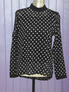 Camisa Blanca con corazones negros €21.90