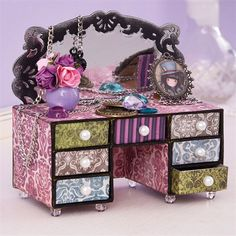 Santoro's Gorjuss Mini Matchbox Dresser Tutorial   Make your own little mini-dresser to brighten up a full-size dresser, a doll's house or to languish beautifully on a shelf, keeping all your mini trinkets safe and sound