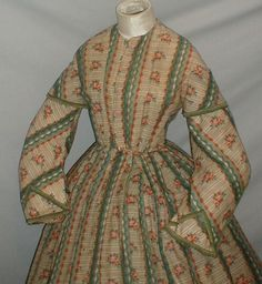 "front detal - Captivating 1860s Printed Challis Dress Museum de Accessioned | eBay fiddybee; coat sleeves with short cap & decorated with green silk ribbon, neck, armscyes & waist are piped, bodice line with cotton, front hook & eye closure; skirt unlined except wide band at hem; light underarm discoloration, skirt some pea size holes & stress wear; bust: 34""; waist: 26""; skirt length: 41""; width at hem: 154"""