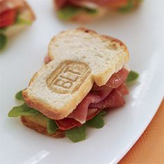 Imagine a BLT after a gourmet makeover: These mini sandwiches, ID'ed by means of a branding iron, are stuffed with Parma prosciutto (Italian ham), arugula and roasted tomatoes. Hors d'ouevres created by Creative Edge Parties, NYC, creativeedgeparties.com.