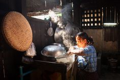 Kitchen, Yangon | A woman is cooking noodles in her restaurant kitchen in Yangon (Rangoon
