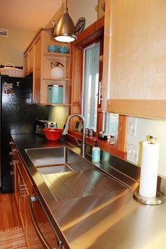 Stacia's one-piece, custom kitchen stainless steel sink and counter top