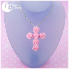 ♥ Blooming cross Necklace ♥ Materials: polymer clay Size of the pendant: 5.5x4 cm Size of the chain: 42 cm We've made our best to portray the colors of jewelry as accurately as possible, however colors will vary with individual monitors and subject to individual opinion.