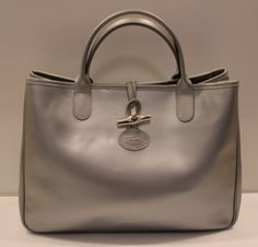Longchamp - Silver Leather Tote from the Handbag Consignment Shop  http://www.handbagconsignmentshop.com/bags/handbags/longchamp-roseau-leather-tote-shopper-in-metallic-silver/
