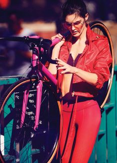 Looking red-hot, Hilary Rhoda wears Hilfiger Collection jacket, Aerie sports bra, Nike leggings and Gentle Monster sunglasses