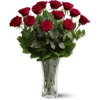 One Dozen Red Roses. For classic romance, a dozen red roses is always the perfect choice. One dozen long-stemmed red roses in a clear glass vase.