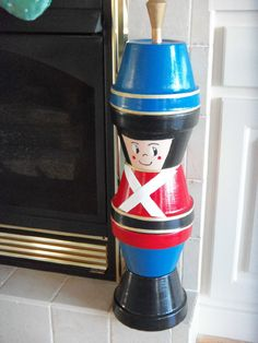 Christmas Nutcracker that I made from clay flower pots.