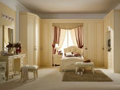 this would be my dream room ,, reminds me of Audrey Hepburn's apartment in Charade,, love the built in closets.