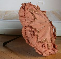 1869 Parasol - total length. 58 cm, wood handle and tip. C Alotta in taffeta russet, with trimmings, lining in ivory taffeta. ____ (translated by Google from Italian)