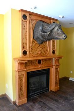 fcb93626cf142 This fireplace was custom designed for a client who wanted to showcase his  water buffalo head. The mantle
