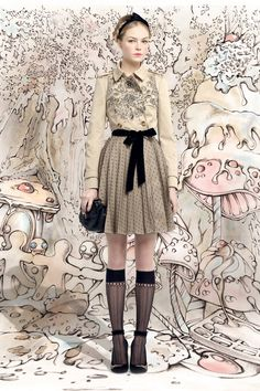 "FALL 2013 READY-TO-WEAR  Red Valentino /   Fashion is always something of a fairy tale, but even more so when designers Pierpaolo Piccioli and Maria Grazia Chiuri are the ones telling the story. For Red Valentino's new Fall lineup, the design duo drew inspiration from the childhood fable of ""Hansel and Gretel."" (No, their version looks nothing like the Jeremy Renner-Gemma Arterton flick currently in theaters.) They've touched upon folkloric themes in the past."