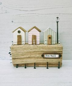 Check out this item in my Etsy shop https://www.etsy.com/uk/listing/540130678/sea-wall-driftwood-art-beach-hut-wood