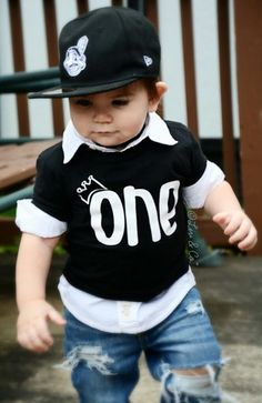 Every little prince turning one year old needs this adorable tee to ring in his first B-Day celebration!Our crownONE birthday shirt comes in several color& age options. We can do this for a 1/2 1st, 2nd, 3rd, 4th, and 5thboys Birthday shirt. Snag this cutie in black with white or goldwriting, red with white or gold writing, or white (with black writing)! This shirt is unique and cannot be found anywhere else as I've designed and made these myself as well as all the others. #LivAndCo