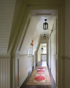 Narrow Hallways-long skinny rug, panneled walls, beautiful light fixtures.  Martinique hallway.