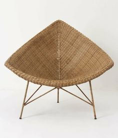 "Anthropologie's 'Naida' chair is really George Nelson's ""Coconut Chair"" Wickerized!!"