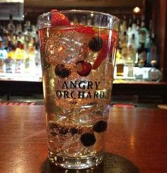 THIS!!! ANGRY CRISP MOJITO made with 1oz. white rum 4 slices of strawberry a couple blueberries 4 mint leaves and 6oz. of Angry Orchard Crisp Apple over ice.