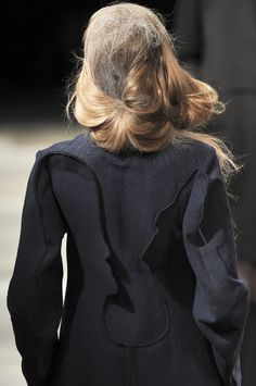 Yohji Yamamoto | Fall 2010 ***seam details gone rogue...are these outlines of faces???? s-c