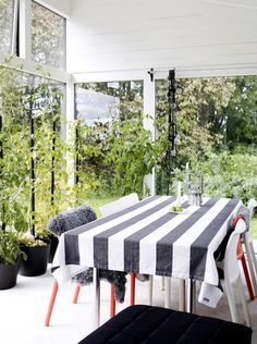 With more window than wall, Swedish designer Agneta Enzell's tiny backyard outbuilding breaks down the barriers between indoors and out.