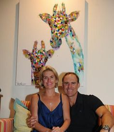 matthew hayden and his wife, kelly with tracey keller giraffe painting