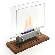 Made from high-grade 18/10 stainless steel and glass, this tabletop fireplace by Carl Mertens