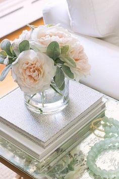 Faux silk flower arrangement as side table decor