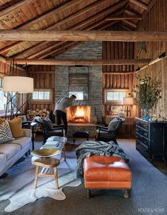 living room with a stone fireplace and comfortable armchairs set nearby is particularly cherished. Comfortable Living Rooms, Cozy Living Rooms, Home Living Room, Living Room Decor, Log Cabin Living, Log Cabin Homes, Don Pollo, Modern Log Cabins, Rustic Cabins