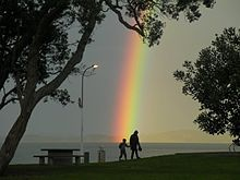 Rainbow after sunlight bursts through after an intense shower in Maraetai, New Zealand.   - Wikipedia