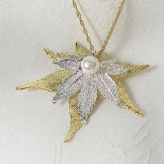 "Dipped Real Maple Leaf Pearl 18"" Pendant Necklace 24K Gold and Sterling Silver Nyya,http://smile.amazon.com/dp/B00FHHP2L8/ref=cm_sw_r_pi_dp_HYmEtb02SFN70S4M"