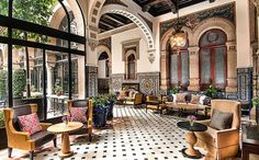 An insider's guide to the best hotels in Seville, featuring the top places to stay for rooftop dining, traditional courtyards, Moorish design and warm service, in central Seville near points of interest such as the Macarena Basilica, La Giralda and Alcazar Palace.