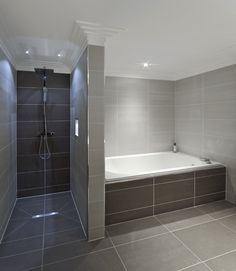Soft lighting and dramatic tile blend perfectly. | http://www.devinebath.com/ #Bathroom