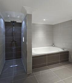 Soft lighting and dramatic tile blend perfectly. | http://www.devinebath.com/ #bathroom | Colocación porcelanatos. Líneas y terminaciones.