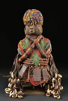 Africa | Fali doll from northern Cameroon | Wood, cloth, glass beads, coloured discs, cowrie shells, leather strips, iron, metal amulets and leather amulets