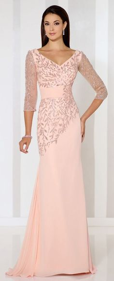 Chiffon sheath with glitter printed illusion three-quarter length sleeves, front and back V-necklines, glitter printed bodice with asymmetrically dropped waist and ruched midriff, sweep train.