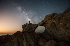 "Sea Arch Stargazer ""This wasn't a shot I had originally planned on before arriving, but as soon as I saw the way things were lining up, I knew it had potential to be awesome. I climbed around on the rocks until I found the right angle. I really loved how the core of the Milky Way lined up directly above the Arch."""