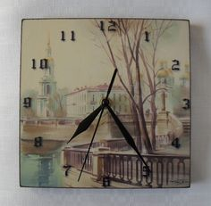 Handmade item: wood, self-created photo-paper clock face (graphic design), acrylic paint, acrylic finish, tin clock hands, clock mechanism.