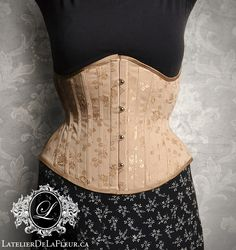 This underbust corset was made for a client with scoliosis. As you can see from the first wearing, the busk is nice and vertical, something that would not be possible with a symmetrical corset. Eventually this piece will lace closed (a little extra room is visible in the hips here). It's always a treat when a client wants to wear their new corset home from their pick-up appointment because they love the feeling so much. Many thanks to my client Margot for allowing me to take some photos of her! Toronto, Boned Corsets, Scoliosis, Underbust Corset, Couture, Bespoke, Steel, Nice, Room