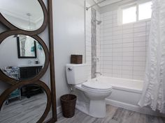 Black Team: Master Bathroom, After  - Flipping the Block: Tour the Finished Bathrooms  on HGTV....like the flooring