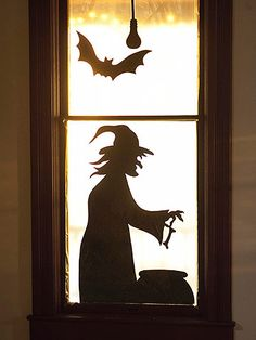 Witch at the Window Silhouette    This witch creeping in your front window gives the impression of a haunted house. The silhouette implies that something sinister is going on. Download our free pattern, enlarge to desired size, trace onto heavy black crafts paper. Cut out the silhouette and adhere to window with double-stick tape.
