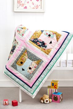 Who could resist Corinne Bradd's cuddly quilt with several cat faces peeping out? The Memory Lane collection from Tilda, featuring ditsy floral prints in pretty colours, gives this design a lovely vintage feel that is enhanced by the crochet lace border. This would look lovely draped over the sofa and hanging on the wall for all to see, or would make a thoughtful baby gift for a new arrival!