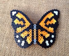 Made from Perler melting/fuse beads. Made to order, ANY COLOR. I have the one pictured in stock, ready to go today! Orders usually ship the next