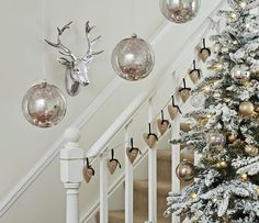 giant Lit Baubles in mercury silver and white frosted tree from Next UK