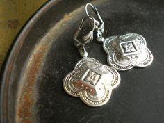 Medea Bright Antique Silver Quatrefoil Earrings. $14.00, via Etsy.