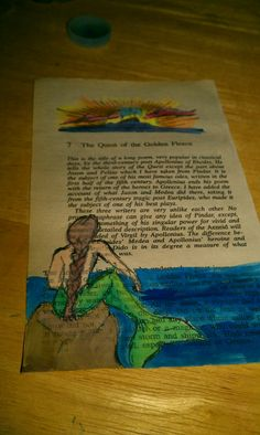 Watercolor mermaid on page from mythology book